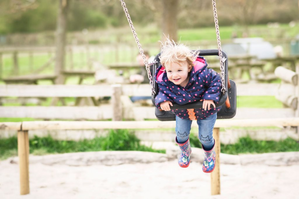 Family photographer in Bournemouth and Poole. Children photographer in Dorset. Photoshoot on the playground