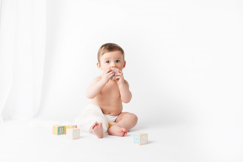 Baby Milestone Photography. Sitter photography session. All-white studio photography. Minimalistic baby photography