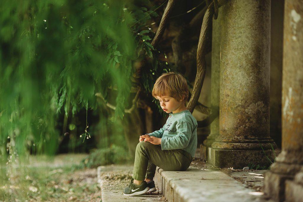 Little boy sitting on the porch